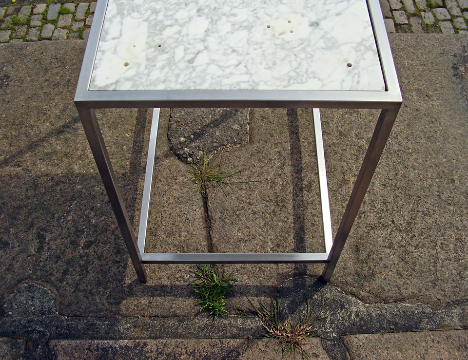 Rectangular outdoor table with marble top - stainless steel and reclaimed marble plate of a washbasin - by Erik Cox