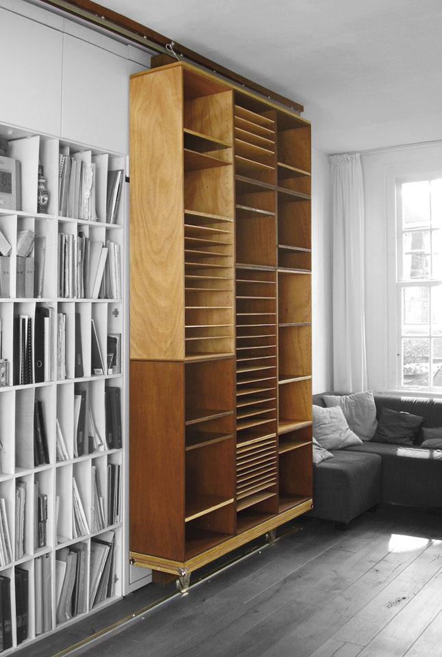 Wheeled bookcase for a music teacher's small one-room flat in Amsterdam by Erik Cox
